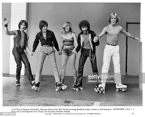 Actors Patrick Swayze Scott Baio actress Maureen McCormick actors Ron Palillo and Greg Bradford in a scene from the movie Skatetown USA circa 1979