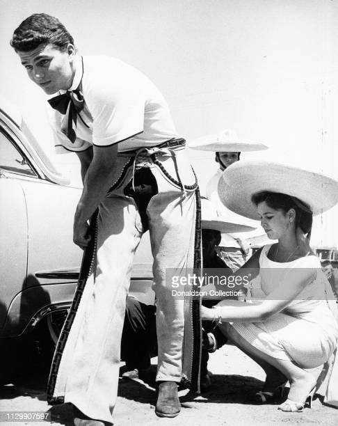 Actors Patrick Wayne and Yvonne Craig on the set of a movie in 1959