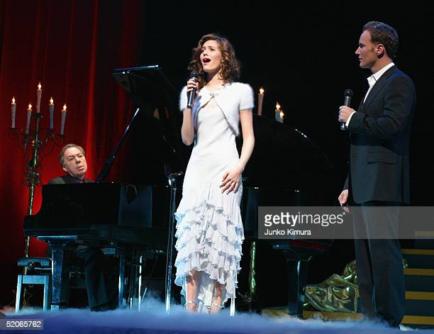 """Actors Patrick Wilson and Emmy Rossum perform while Sir Andrew Lloyd Webber plays the piano, during the premiere for """"The Phantom of the Opera""""..."""