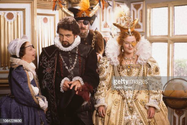 Actors Patsy Byrne, Rowan Atkinson, Stephen Fry and Miranda Richardson in a scene from episode 'Potato' of the BBC television sitcom 'Black Adder...