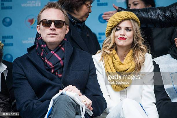 Actors Paul Bettany and AnnaLynne McCord attend the 2015 International Women's Day March at Dag Hammarskjold Plaza on March 8 2015 in New York City