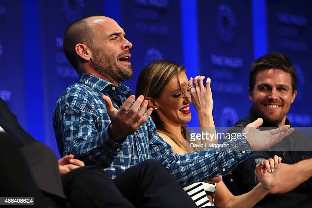 Actors Paul Blackthorne Katie Cassidy and Stephen Amell appear on stage during the Arrow The Flash event at The Paley Center For Media's 32nd Annual...
