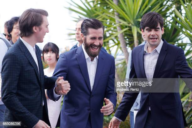 Actors Paul Dano Jake Gyllenhaal and Devon Bostick attend the Okja photocall during the 70th annual Cannes Film Festival at Palais des Festivals on...