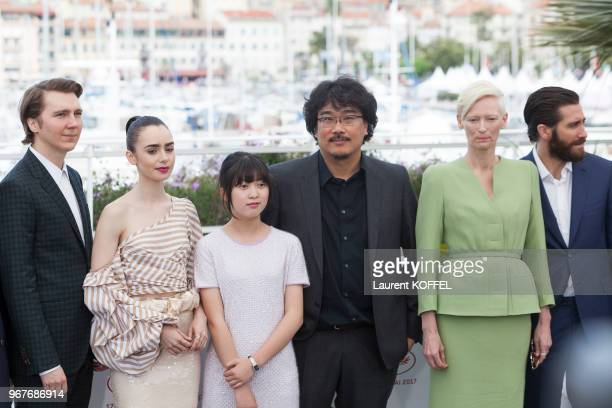 Actors Paul Dano Lily Collins Ahn SeoHyun director Bong JoonHo Tilda Swinton and Jake Gyllenhaal attend the 'Okja' photocall during the 70th annual...