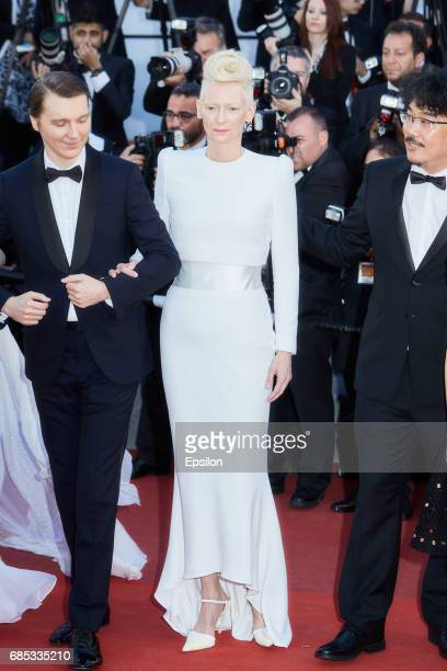 """Actors Paul Dano, Tilda Swinton, director Bong Joon-Ho attend the """"Okja"""" screening during the 70th annual Cannes Film Festival at Palais des..."""