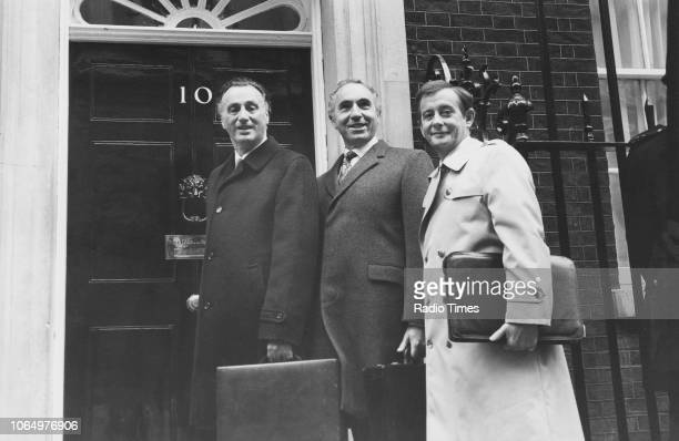 Actors Paul Eddington Nigel Hawthorne and Derek Fowlds outside 10 Downing Street in a scene from the television sitcom 'Yes Minister' London October...