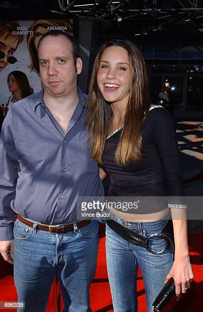 Actors Paul Giamatti and Amanda Bynes attend the premiere of the film Big Fat Liar February 2 2002 at Universal Studios in Los Angeles CA