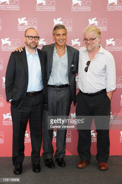Actors Paul Giamatti Philip Seymour Hoffman and director George Clooney attend the The Ides of March Photocall during the 68th Venice International...