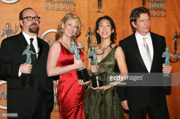 Actors Paul Giamatti, Virginia Madsen, Sandra Oh and Thomas Haden Church pose in the press room with their Actors for Outstanding Performance by a...