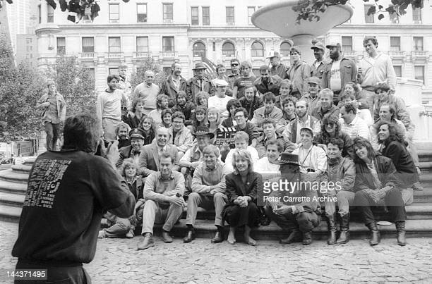 Actors Paul Hogan and Linda Kozlowski pose with the cast and crew on the set of their new film 'Crocodile Dundee' in 1986 in New York City