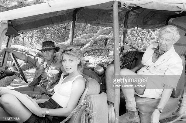 Actors Paul Hogan Linda Kozlowski and John Meillon on the set of their new film 'Crocodile Dundee' in 1986 on location in the Northern Territory...