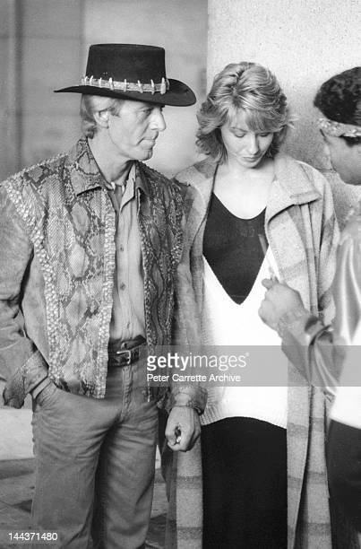 Actors Paul Hogan Linda Kozlowski and Tony Holmes on the set of their new film 'Crocodile Dundee' in 1986 in New York City