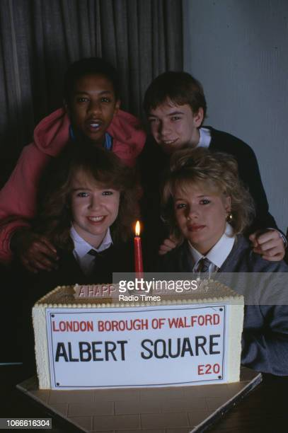 Actors Paul J Medford Adam Woodyatt Letitia Dean and Susan Tully pictured with a celebration cake on the set of the BBC soap opera 'EastEnders' April...
