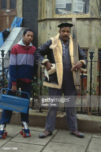 Actors Paul J Medford and Oscar James pictured on the exterior set of the BBC soap opera 'EastEnders' November 21st 1984