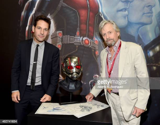 Actors Paul Rudd and Michael Douglas attend Marvel's 'AntMan' Hall H Panel Booth Signing during ComicCon International 2014 at San Diego Convention...