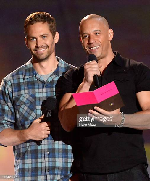 Actors Paul Walker and Vin Diesel speak onstage during the 2013 MTV Movie Awards at Sony Pictures Studios on April 14, 2013 in Culver City,...