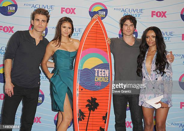 Actors Paul Wesley Nina Dobrev Ian Somerhalder and Kat Graham poses in the press room during the 2012 Teen Choice Awards at Gibson Amphitheatre on...