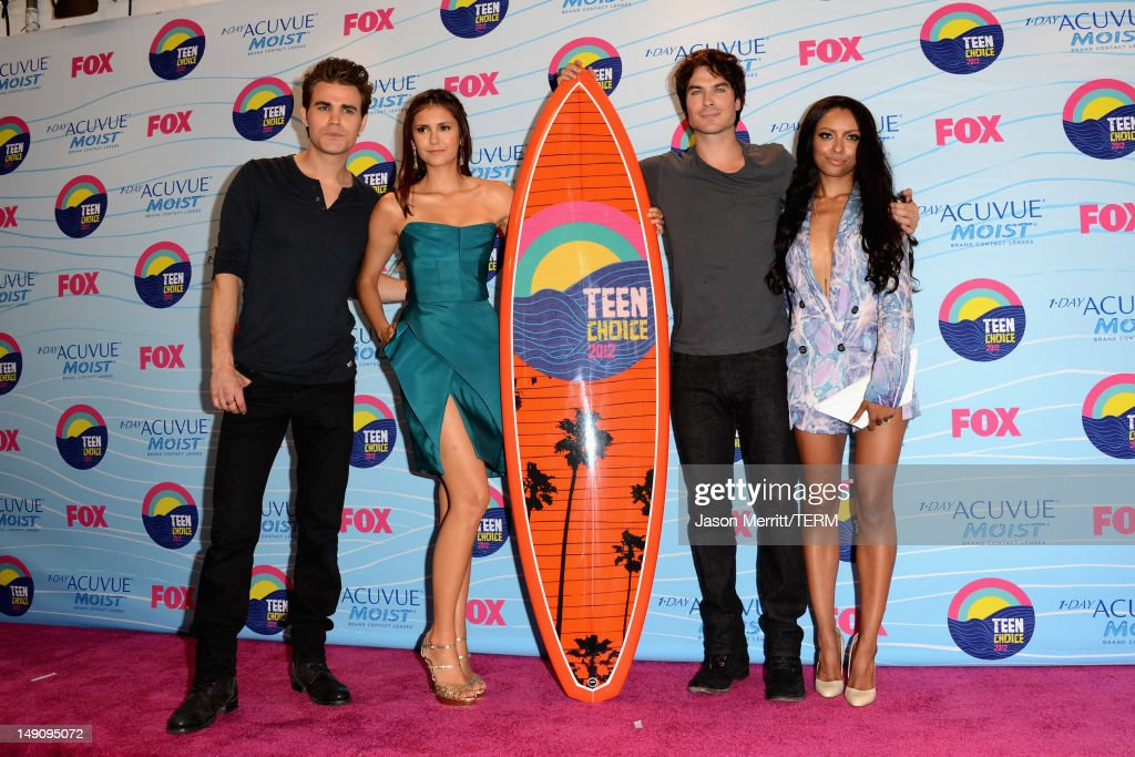 Actors Paul Wesley, Nina Dobrev, Ian Somerhalder, and Kat Graham, winners of Choice Fantasy/Sci-Fi Show award, pose in the press room during the 2012 Teen Choice Awards at Gibson Amphitheatre on July 22, 2012 in Universal City, California.