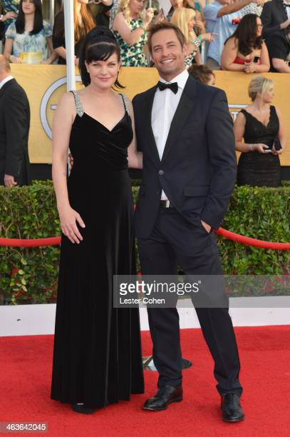 Actors Pauley Perrette and Josh Holloway attend the 20th Annual Screen Actors Guild Awards at The Shrine Auditorium on January 18 2014 in Los Angeles...
