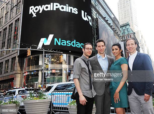 Actors Paulo Costanzo Ben Shenkman Reshma Shetty and producer Michael Rauch of USA Network's 'Royal Pains' ring the NASDAQ Closing Bell at NASDAQ on...