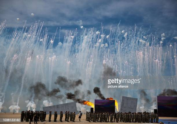 Actors peform on occasion of the 70th anniversary of the landing troops of the Allies in the Normandy in front of the castle of Bénouville in...