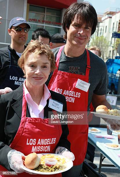 Actors Peggy McCay and Patrick Muldoon volunteer at the Los Angeles Mission during Easter on April 2 2010 in Los Angeles California