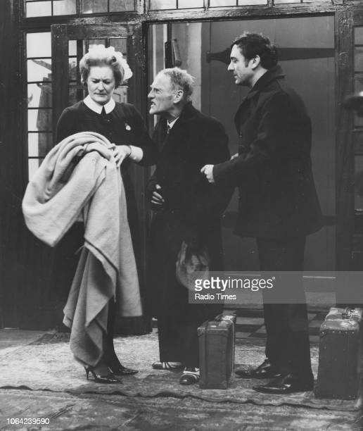 Actors Peggy ThorpeBates Wilfrid Brambell and Harry H Corbett in a scene from episode 'Homes Fit for Heroes' of the television sitcom 'Steptoe and...