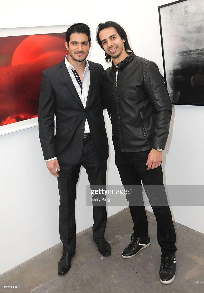 Actors Pepe Gamez and Cesar D' La Torre attend 'Hindsight is 30/40 - A Group Photographer Exhibition' at The Salon at Automatic Sweat on November 12, 2016 in Los Angeles, California.