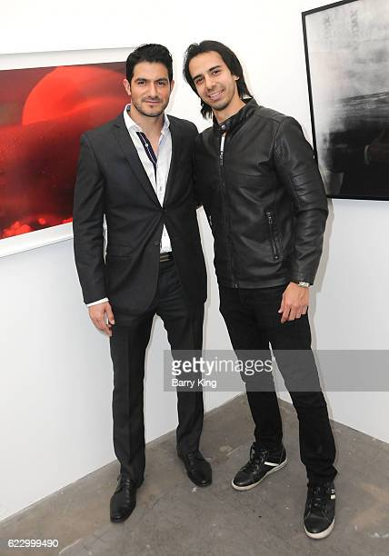 Actors Pepe Gamez and Cesar D' La Torre attend 'Hindsight is 30/40 A Group Photographer Exhibition' at The Salon at Automatic Sweat on November 12...
