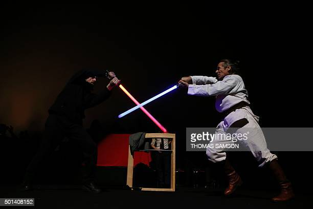 Actors perform a lightsaber fight during the Darth Vader's trial event at the Grand Rex movie theatre in Paris on December 14 two days ahead of the...