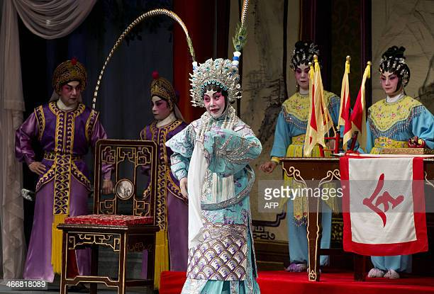 Actors perform at the West Kowloon Bamboo Theatre a 800seat temporary theatre to house a series of Cantonese opera shows in Hong Kong on February 4...