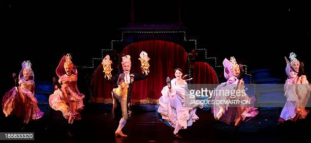 Actors perform during a dress rehearsal of the Beauty and the Beast The Broadway Musical at the Mogador theater in Paris on October 24 2013 AFP PHOTO...