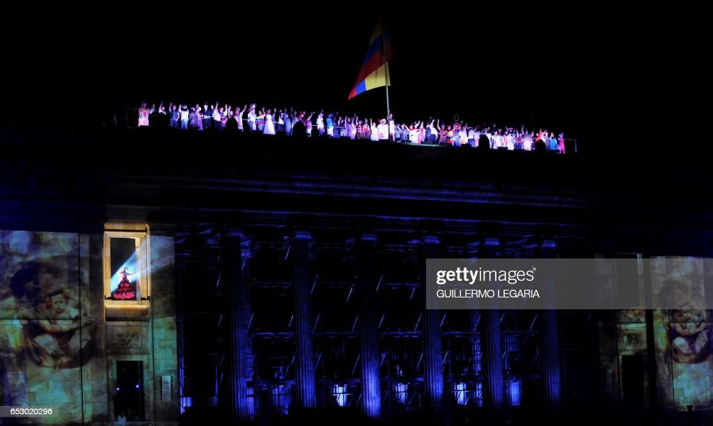 Actors perform during a show at Bolivar square in Bogota on July 20, 2010 during celebrations marking the Bicentenary of the Independence of Colombia