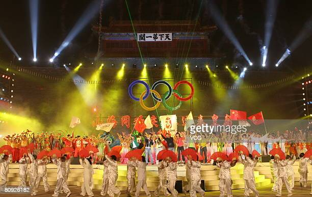 Actors perform during an event celebrating the 100 day Olympic countdown.Chinese authorities are organizing various events including a long-distance...