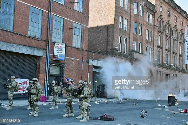 Actors perform during filming for a new low budget horror film Zombie Apocalypse on April 19 2016 in Glasgow Scotland Washington Street in the city...