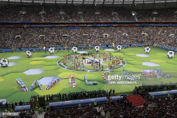 Actors perform during the opening ceremony before the Russia 2018 World Cup Group A football match between Russia and Saudi Arabia at the Luzhniki...