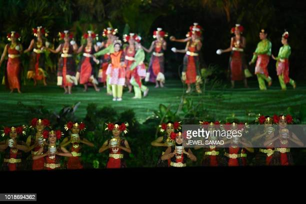 Actors perform during the opening ceremony of the 2018 Asian Games at the Gelora Bung Karno main stadium in Jakarta on August 18 2018