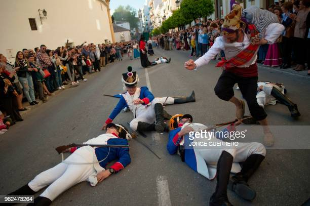 Actors perform during the reenactment of a battle of the Spanish War of Independence against France in Ronda southern Spain on May 25 2018 Ronda...