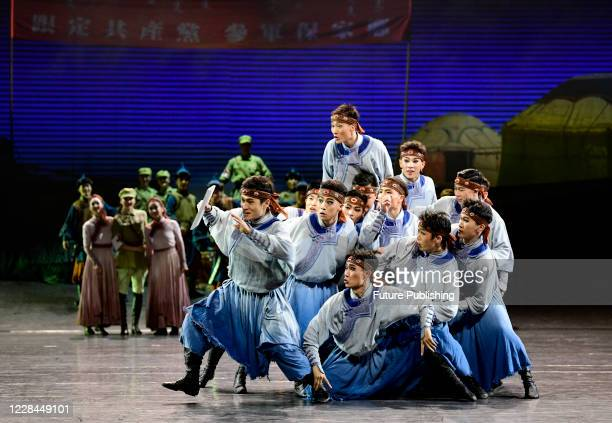 Actors perform in a large original national dance drama cavalry, Hohhot, Inner Mongolia, China, September 10, 2020.- PHOTOGRAPH BY Costfoto /...