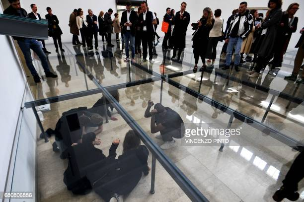 """Actors perform in """"Faust"""" by German artist Anne Imhof during the press preview of the 57th International Art Exhibition Biennale, on May 9, 2017 in..."""