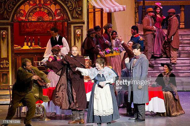 Actors perform in Giacomo Puccini's 'La Boheme' at the National Theatre in Santo Domingo on August 7 2013 'La Boheme' is an opera of four acts based...