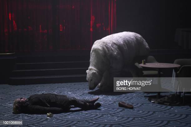 """Actors perform in the play """" Arctique"""" directed by Belgian Anne-Cecile Vandalem on July 17 during the 72nd International Theatre festival in Avignon."""