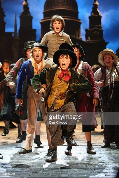 Actors perform on stage during a rehearsal of Lionel Bart's musical adaptation of 'Oliver' at the Theatre Royal, Drury Lane on January 12, 2009 in...