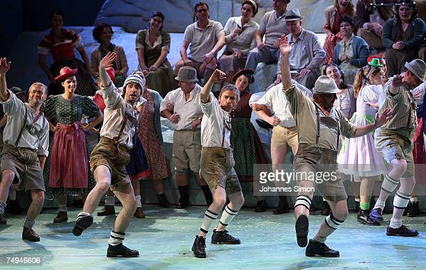 Actors perform on stage during the rehearsal of the operetta 'Weisses Roessl' prior to the Thurn und Taxis castle festival on June 28 in Regensburg...