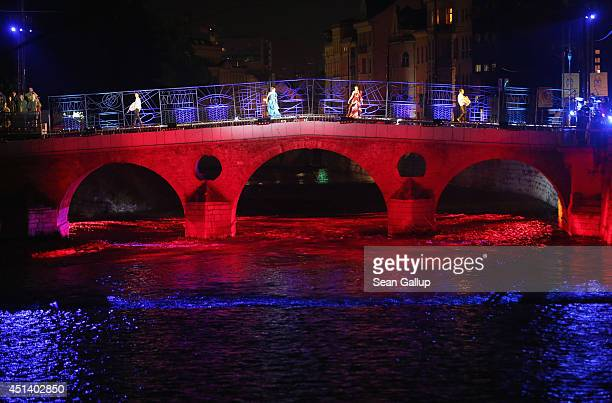 Actors perform on the Latin Bridge during a theatrical piece commemorating World War I near the spot where Serbian secessionist Gavrilo Princip shot...