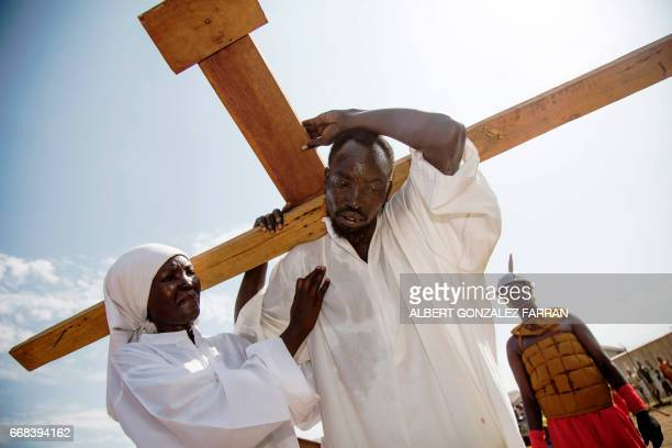TOPSHOT Actors perform the roles of Jesus Christ and virgin Mary during the Good Friday procession ahead of Easter in Juba South Sudan on April 14...