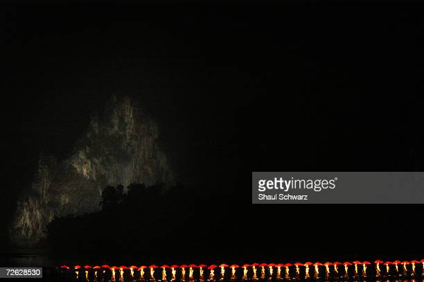 Actors perform the Yangshuo River light show at the confluence of the LI and Yulong Rivers on February 12 2005 in Yangshuo China The show is based on...