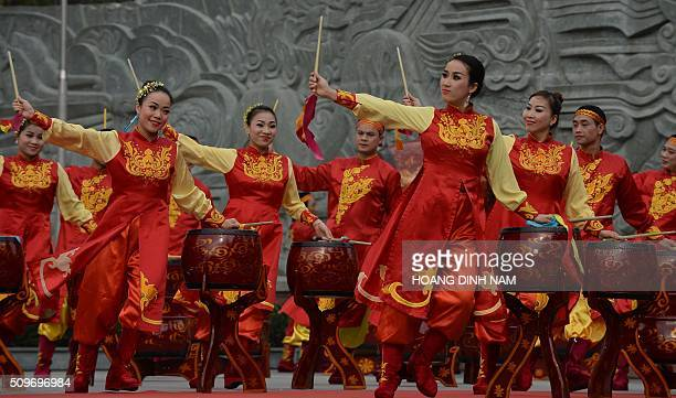 Actors perform with drums during a ceremony marking the 227th anniversary of the Vietnam's Dong DaNgoc Hoi victory over China's Qing dynasty's troops...