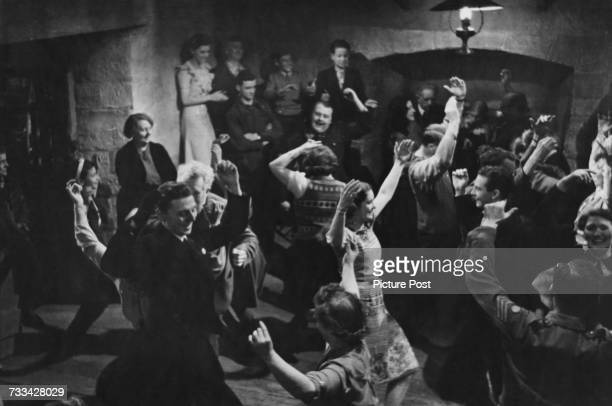 Actors performing a cèilidh sequence on the set of 'I Know Where I'm Going' directed by Michael Powell and Emeric Pressburger 1945 Original...