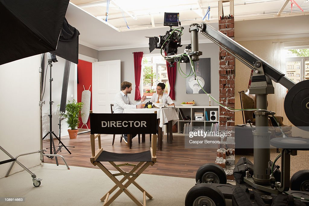 Actors performing a scene on a film set : Stock Photo